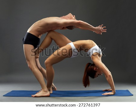 Yoga. Sensual composition of flexible athletes
