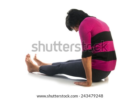 Yoga seria: Mature woman in Dandasana or Staff Pose yoga pose isolated on white background. - stock photo