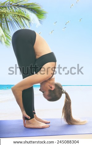 Yoga seria: Woman in uttanasana pose - stock photo