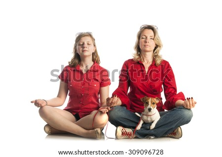 Yoga series: woman and girl sitting on the floor in Easy yoga pose (Sukhasana) with Jack Russell Terrier puppy,  isolated on white background. - stock photo