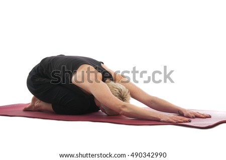 Yoga series: young woman in Balasana yoga Pose isolated on white background. Balasana, Child's Pose or Child's Resting Pose is an asana