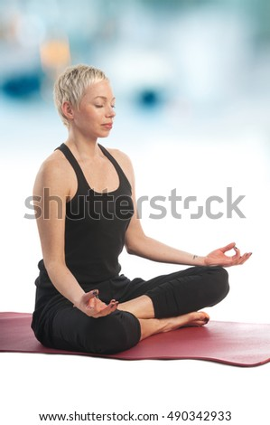 Yoga series: young woman in Easy yoga pose (Sukhasana)  on blerred background