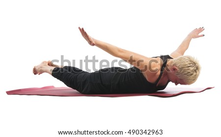 Yoga series: young woman in Makarasana yoga Pose isolated on white background. Makarasana  Pose is an asana