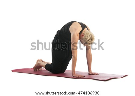 Yoga series: young woman in Marjaryasana yoga Pose isolated on white background