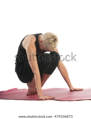 Yoga series: young woman in modificated Tolasana yoga Pose (Scale Pose) isolated on white background