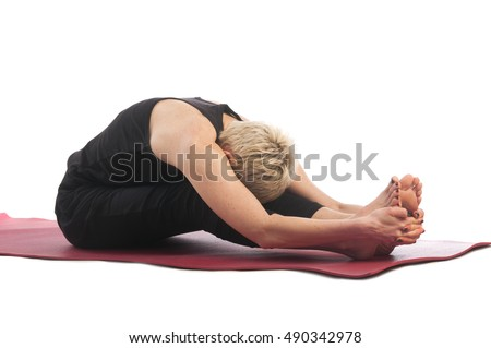 Yoga series: young woman in paschimottanasana yoga Pose isolated on white background