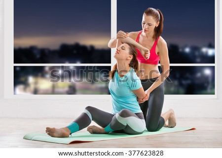 Yoga training with trainer - stock photo