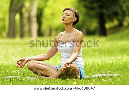 Yoga woman in lotos position with closed eyes.