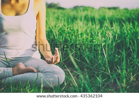 Yoga woman In the lotus posture.with sunrise - stock photo