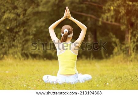 Yoga woman meditates outdoors - stock photo
