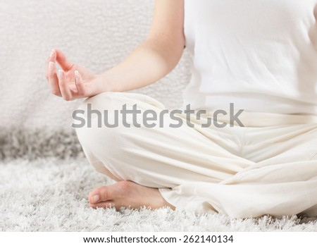Yoga Woman Meditating Relaxing at home.Close-up of unrecognizable female hand in lotus posture. Healthy Lifestyle.