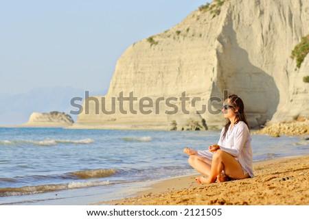 Yoga workout at the beach on Corfu island, Greece - stock photo