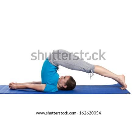 Yoga young beautiful woman yoga instructor doing plow pose asana