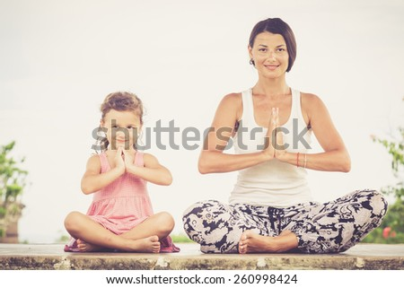 Yoga. Young woman doing yoga exercise outdoor at the day time. - stock photo