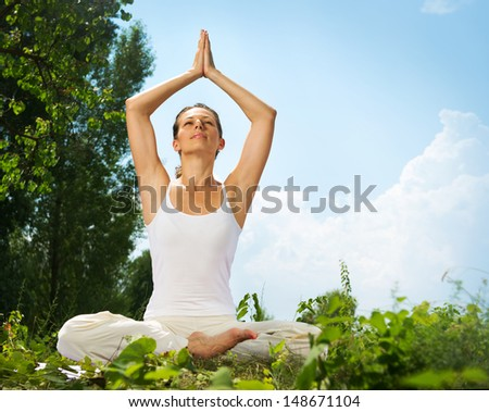 Yoga. Young Woman doing Yoga Exercises Outdoor  - stock photo