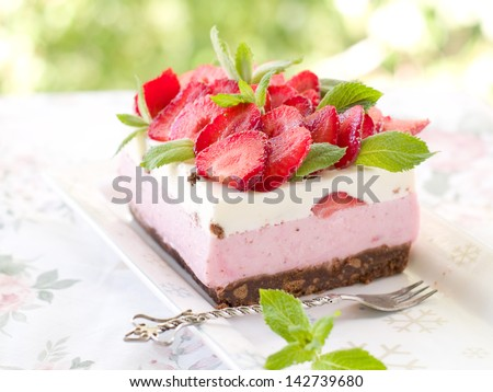 yoghurt cheesecake with fresh strawberry, selective focus - stock photo