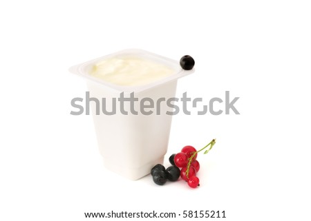 Yoghurt in a plastic container with berries isolated on white background - stock photo