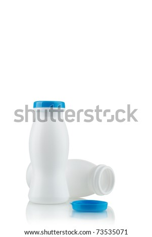 Yoghurt in white bottles on a white background - stock photo