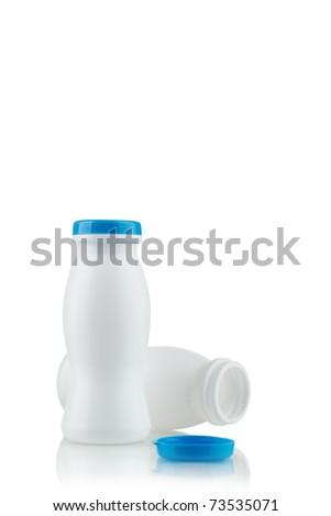 Yoghurt in white bottles on a white background - stock photo