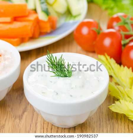 yoghurt sauce with herbs to assorted fresh vegetables, close-up