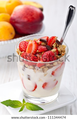 yoghurt with granola and strawberries in glass - stock photo
