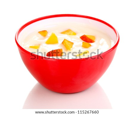 Yoghurt with peach in bowl isolated on white - stock photo