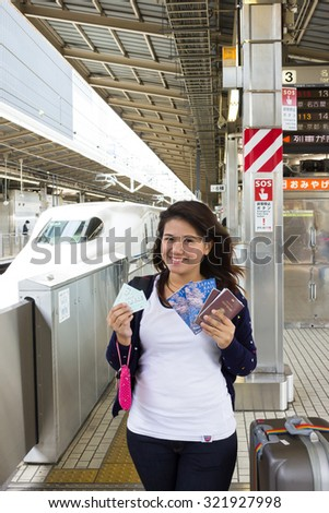 YOGOHAMA, JAPAN - 15 April 2015 :Thailand tourists toured Japan is extremely popular. After the abolition of visas for tourists, Thailand tourist woman traveling with large bag and railway ticket. - stock photo