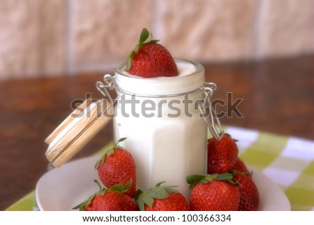 yogurt and strawberries in glass jar