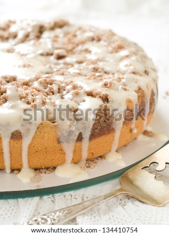 Yogurt coffee cake with streusel ans sauce, selective focus