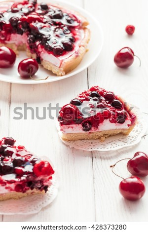 Yogurt dessert with berries. Summer dessert on wooden white background. Top view - stock photo