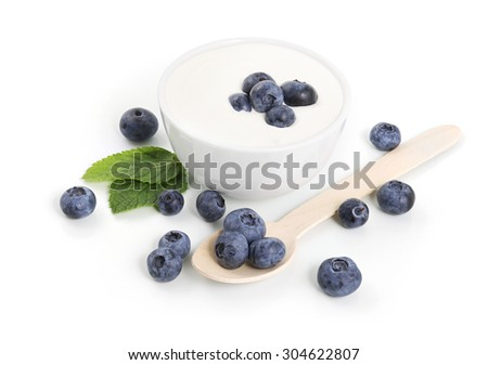 Yogurt in a bowl with blueberries on white background