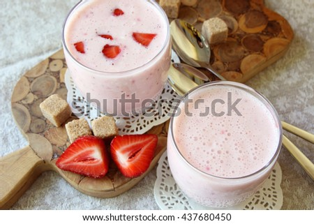 Yogurt with banana and strawberry in the glass.