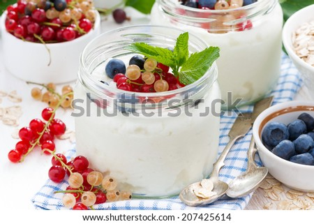 yogurt with berries and products for healthy breakfast, close-up, horizontal