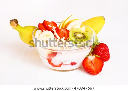 Yogurt with exotic fruits and cereals on a white background