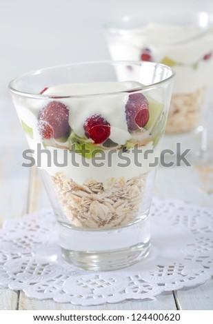 yogurt with fruit and oat flakes - stock photo