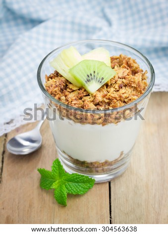 Yogurt with granola and fruits. Concept of healthy eating for breakfast. - stock photo