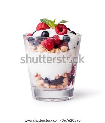 yogurt with muesli and berries on white background  - stock photo