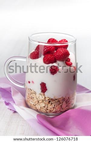 yogurt with muesli and fruits for breakfast - stock photo