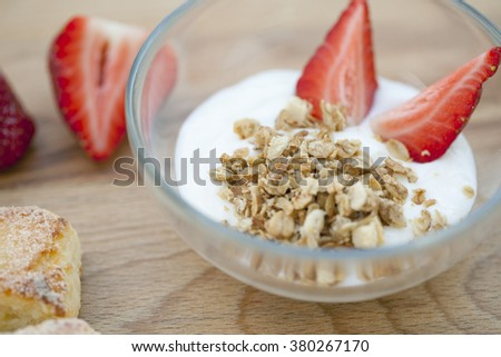 yogurt with muesli and strawberries, a delicious dessert with berries and cookies, healthy Breakfast, macro - stock photo