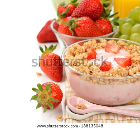 Yogurt with muesli on white background