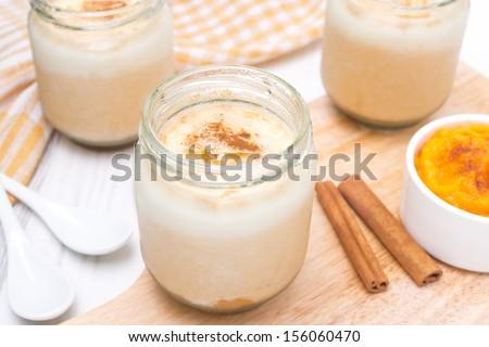 yogurt with spiced pumpkin puree in portioned jars, horizontal - stock photo