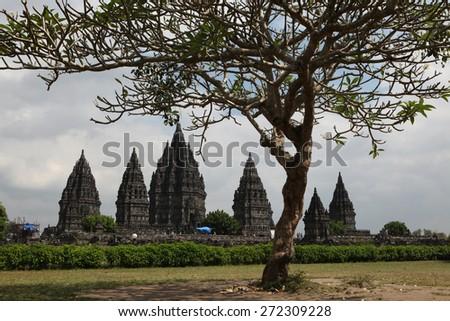 YOGYAKARTA, INDONESIA - AUGUST 4, 2011: Tourists visit the Prambanan Temple near Yogyakarta, Central Java, Indonesia. - stock photo