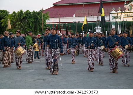 YOGYAKARTA, INDONESIA - CIRCA SEPTEMBER 2015: Ceremonial Sultan Guards in sarongs march in front of Sultan Palace (Keraton), Yogyakarta, Indonesia