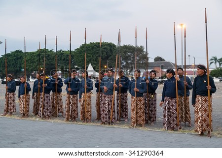 YOGYAKARTA, INDONESIA - CIRCA SEPTEMBER 2015: Ceremonial Sultan Guards in sarongs standing with spears in front of Sultan Palace (Keraton), Yogyakarta, Indonesia