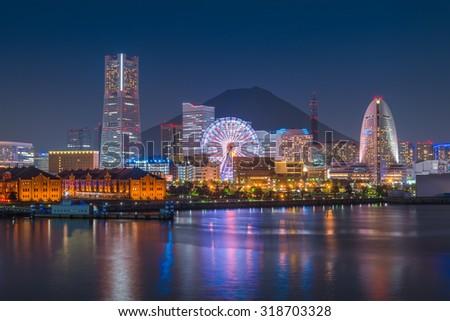 Yokohama city skyline over the Mt Fuji at sunset time - stock photo