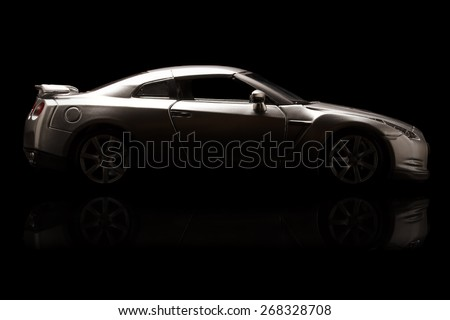 YOKOHAMA, JAPAN - APR 04- Toy Nissan GT-R on black background. A small amount of light, Saturday 04 April 2015 - stock photo