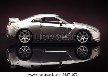 YOKOHAMA, JAPAN - APR 04- Toy Nissan GT-R on purple  background, Saturday 04 April 2015 - stock photo