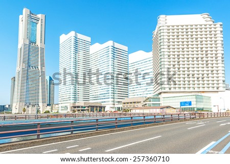 YOKOHAMA, JAPAN - February 28: Yokohama Minato Mirai 21 in Yokohama City, Japan on February 28, 2015. It is a large urban development and the central business district of Yokohama, Japan. - stock photo