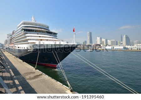 "YOKOHAMA, JAPAN - MARCH 17, 2014: A luxury liner ""Queen Elizabeth"" (90,901 tons) is moored at Osanbashi Pier. She is a cruise ship owned by Carnival Corporation & PLC and is operated by Cunard Line."