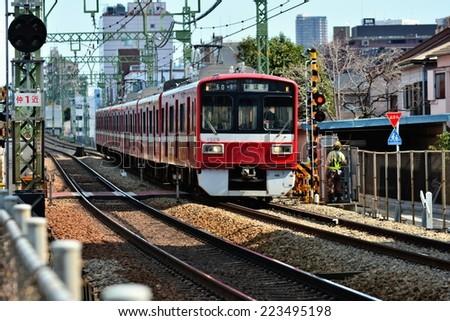 YOKOHAMA, JAPAN - March, 2014:The Keikyu Main Line or Keiky?-honsen is a railway line in Japan, operated by the private railway operator Keikyu.  - stock photo